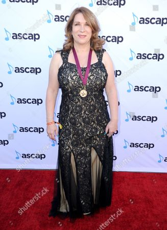 Lindy Robbins, award winner for Want To Want Me by Jason Derulo, arrives at the 33rd annual ASCAP Pop Music Awards at the Dolby Ballroom, in Los Angeles