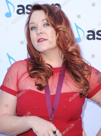 Audra Mae, award winner for Heartbeat Song by Kelly Clarkson and winner of the top song performance award for Heartbeat Song arrives at the 33rd annual ASCAP Pop Music Awards at the Dolby Ballroom, in Los Angeles