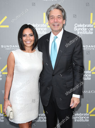 Millennium Entertainment CEO Bill Lee (right) and wife Lisa Lee attend the 2013 'Celebrate Sundance Institute' Los Angeles Benefit at The Lot on in West Hollywood, California