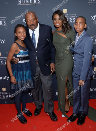 Jim Brown and Monique Brown arrive with their children at the 3rd annual NFL Honors at Radio City Music Hall, in New York
