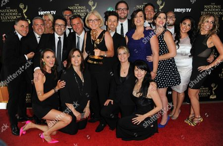 """Mary Connelly, center, and the crew of """"The Ellen DeGeneres Show"""" pose in the press room with the award for outstanding talk show entertainment at the 41st annual Daytime Emmy Awards at the Beverly Hilton Hotel, in Beverly Hills, Calif"""