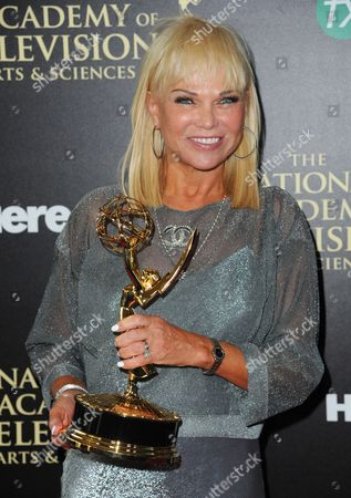 Stock Image of Linda Bell Blue poses in the press room with the award for outstanding entertainment news program for Entertainment Tonight at the 41st annual Daytime Emmy Awards at the Beverly Hilton Hotel, in Beverly Hills, Calif