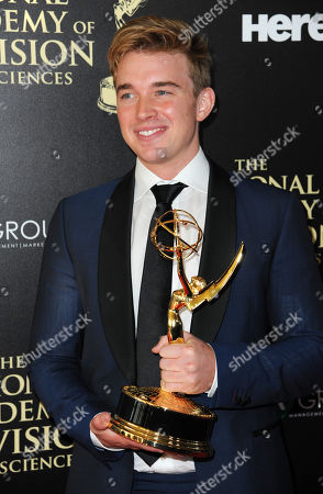 Chandler Massey poses in the press room with the award for outstanding younger actor in a drama series for â?oeDays of our Livesâ?? at the 41st annual Daytime Emmy Awards at the Beverly Hilton Hotel, in Beverly Hills, Calif