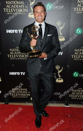 Billy Miller poses in the press room with the award for outstanding lead actor in a drama series for The Young and the Restless at the 41st annual Daytime Emmy Awards at the Beverly Hilton Hotel, in Beverly Hills, Calif