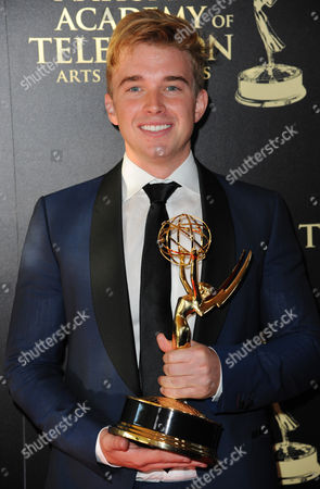 Chandler Massey poses in the press room with the award for outstanding younger actor in a drama series for Days of our Lives at the 41st annual Daytime Emmy Awards at the Beverly Hilton Hotel, in Beverly Hills, Calif