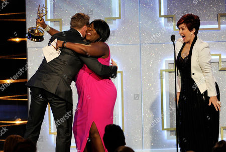 Sharon Osbourne, and from right, Sheryl Underwood present the award for outstanding lead actor in a drama series to Billy Miller for The Young and the Restless at the 41st annual Daytime Emmy Awards at the Beverly Hilton Hotel, in Beverly Hills, Calif