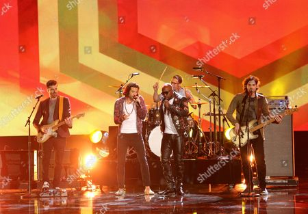 Wyclef Jean, center, and from left, Mark Pellizzer, Nasri, Alex Tanas and Ben Spivak of the musical group Magic! perform on stage at the 42nd annual American Music Awards at Nokia Theatre L.A. Live, in Los Angeles