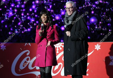 Shaun Robinson, left, and Fritz Coleman host t the 5th annual Holiday Tree Lighting at L.A. Live and opening of LA Kings Holiday Ice, in Los Angeles