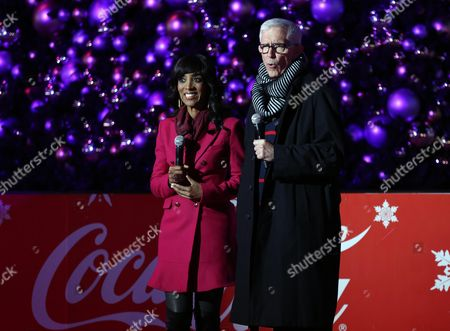 Shaun Robinson, left, and Fritz Coleman are seen at the 5th annual Holiday Tree Lighting at L.A. Live and opening of LA Kings Holiday Ice, in Los Angeles