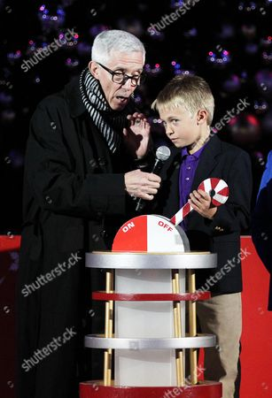 Fritz Coleman, left, and Johnny Hoffman, Junior Ambassador for Children's Hospital Los Angeles, pull the lever to the light the Holiday Tree at the 5th annual Holiday Tree Lighting at L.A. Live and opening of LA Kings Holiday Ice, in Los Angeles