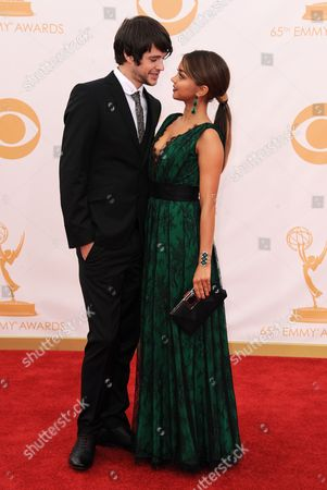 Matt Prokop, left, and Sarah Hyland arrive at the 65th Primetime Emmy Awards at Nokia Theatre, in Los Angeles