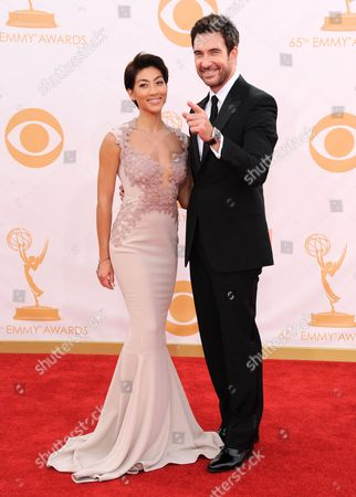 Dylan McDermott, right, and Shasi Wells arrive at the 65th Primetime Emmy Awards at Nokia Theatre, in Los Angeles