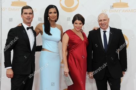 Hugh Acheson, from left, Padma Lakshmi, Gail Simmons, and Tom Colicchio arrive at the 65th Primetime Emmy Awards at Nokia Theatre, in Los Angeles
