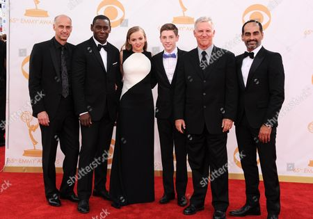 David Marciano, from left, David Harewood, Morgan Saylor, Jackson Pace, Jamey Sheridan and Navid Negahban arrive at the 65th Primetime Emmy Awards at Nokia Theatre, in Los Angeles