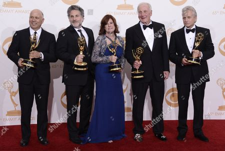 Michael Polaire, Gregory Jacobs, Susan Ekins, Jerry Weintraub and Michael Douglas, winners of Outstanding Lead Actor in a Miniseries or Movie for 'Behind the Candelabra,' pose backstage at the 65th Primetime Emmy Awards at Nokia Theatre, in Los Angeles