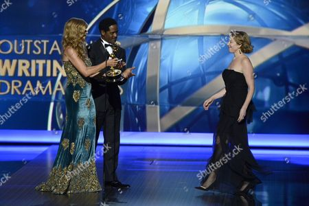 From left, Connie Britton and Blair Underwood present the award for outstanding writing for a drama series to Sarah Bromell on behalf of Henry Bromell at the 65th Primetime Emmy Awards at Nokia Theatre, in Los Angeles