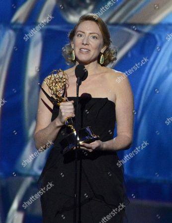 Sarah Bromell on behalf of Henry Bromell accepts the award for outstanding writing for a drama series for his work on â?oeHomelandâ?? at the 65th Primetime Emmy Awards at Nokia Theatre, in Los Angeles
