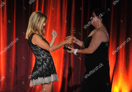 "Beatriz Gomez, Executive Producer of the KMEX news team accepts the award from Dorothy Lucey, left, for live special events-programming for ""Fiestas Patrias"" at the Television Academy's 66th Los Angeles Area Emmy Awards on at The Leonard H. Goldenson Theater in the NoHo Arts District in Los Angeles"