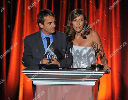 "Stephen Galloway and Brenda Brkusic accept the award for arts & culture/history for ""The Hollywood Reporter in Focus: The Wolf of Wall Street"" on stage at the Television Academy's 66th Los Angeles Area Emmy Awards on at The Leonard H. Goldenson Theater in the NoHo Arts District in Los Angeles"