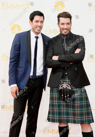 Drew Scott and Jonathan Silver Scott arrive at the 66th Primetime Emmy Awards at the Nokia Theatre L.A. Live, in Los Angeles