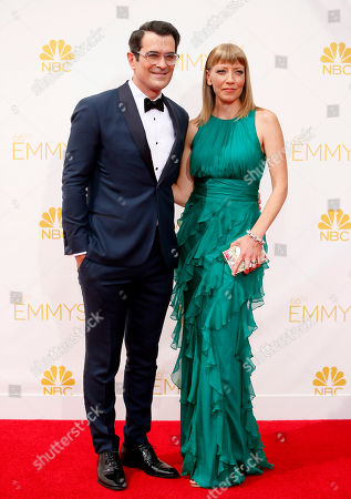 Stock Image of Ty Burrell, left, and Holly Anne Brown arrive at the 66th Primetime Emmy Awards at the Nokia Theatre L.A. Live, in Los Angeles