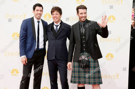 Drew Scott, and from left, J.D. Scott, and Jonathan Silver Scott arrive at the 66th Primetime Emmy Awards at the Nokia Theatre L.A. Live, in Los Angeles