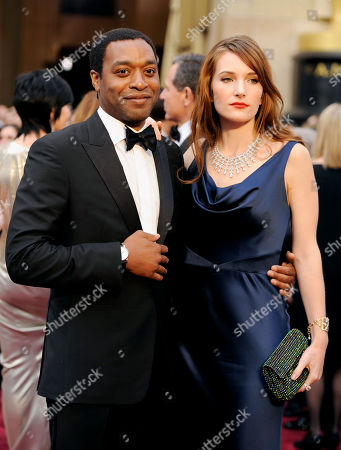 Chiwetel Ejiofor, left, and Sari Mercer arrive at the Oscars, at the Dolby Theatre in Los Angeles