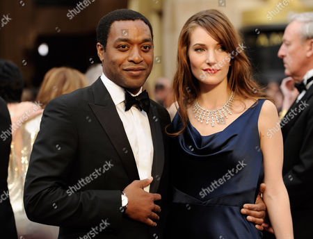 Chiwetel Ejiofor, and Sari Mercer arrive at the Oscars, at the Dolby Theatre in Los Angeles