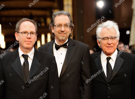 Albert Berger, from left, Bob Nelson and Ron Yerxa arrive at the Oscars, at the Dolby Theatre in Los Angeles