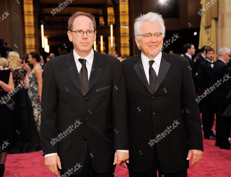 Albert Berger, left, and Ron Yerxa arrive at the Oscars, at the Dolby Theatre in Los Angeles