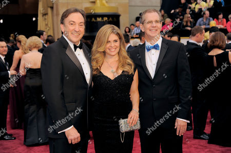 Peter Del Vecho, and from left, Jenifer Lee and Chris Buck arrive at the Oscars, at the Dolby Theatre in Los Angeles