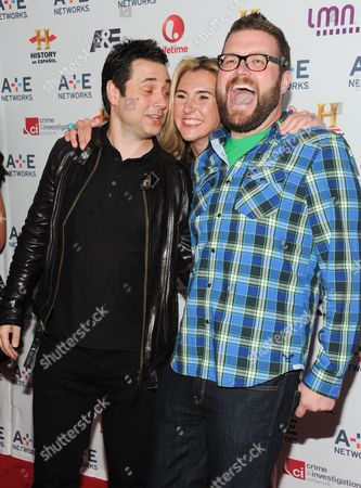 "A+E Networks president, Nancy Dubuc, center, poses between ""Top Gear"" cast members Adam Ferrara, left, and Rutledge Wood at the A+E Networks 2013 Upfront on in New York"