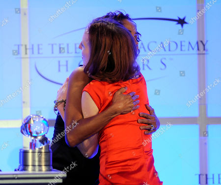 "MAY 5: Creator, Darlene Hunt (R) accepts the award for 'The Big C' ""Taking the Plunge"" from Holly Robinson Peete onstage at the Academy Of Television Arts & Sciences Presents ""The 4th Annual Television Academy Honors"" at the Beverly Hills Hotel, in Beverly Hills, California"