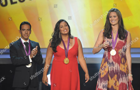 From left, Leonel Manzano, Brenda Villa and Jessica Steffens accept the our olympian award at the ALMA Awards, in Pasadena, Calif