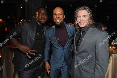 From left, Dohn Norwood, Common and Anson Mount attend the AMC, IFC, Sundance Channel Emmy After Party, on in West Hollywood, Calif