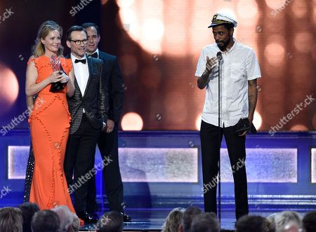 """Keith Stanfield, right, from """"Atlanta,"""" interrupts as Leslie Mann, from left, and Christian Slater present the award for best comedy series to """"Silicon Valley"""" at the 22nd annual Critics' Choice Awards at the Barker Hangar, in Santa Monica, Calif"""