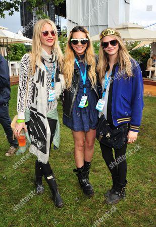 Poppy Delevigne, Zara Martin, Chloe Develigne poses in the Barclaycard Unwind Lounge, at the Barclaycard Wireless Festival 2012 on in London
