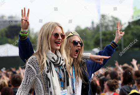 Stock Image of Chloe Delevigne, Poppy Delevigne poses in the Barclaycard Playpen, at the Barclaycard Wireless Festival 2012 on in London