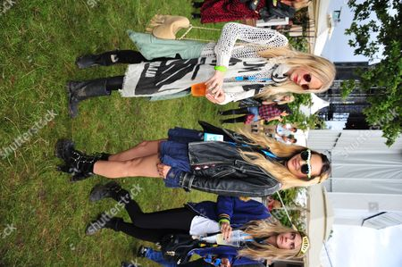 Stock Picture of Chloe Delevigne, Zara Martin, Poppy Develigne poses in the Barclaycard Unwind Lounge, at the Barclaycard Wireless Festival 2012 on in London