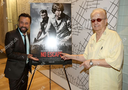 """Yakov Smirnoff, left, and Norby Walters attend the Bold Films Special Screening of """"No Escape"""", in Beverly Hills, Calif"""