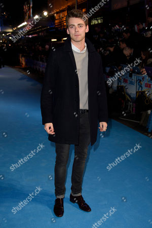 Thomas Law poses for photographers upon arrival at the premiere of the film 'Eddie The Eagle' in London