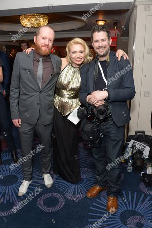 From left, Steve Oram, MyAnna Buring and photographer attend the Jameson Empire Awards 2014 at the Grosvenor Hotel, London
