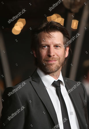 Andrew Tarbet poses for photographers upon arrival at the World premiere of the film Exodus: Gods And Kings in London
