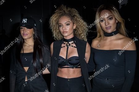 From left, Annie Ashcroft, Frankee Connolly and Nadine Samuels from the band M.O. pose for photographers upon arrival at the Notion Magazine x Swatch Party in London
