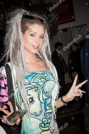 Stock Picture of Fashion designer Alice Vandy poses for photographers upon arrival at the Notion Magazine x Swatch Party in London