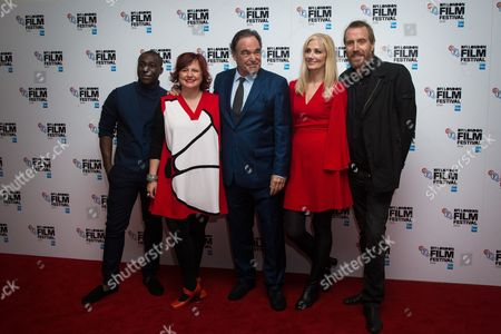 From left, Eric Kofi-Abrefa, Clare Stewart, Director Oliver Stone, Joely Richardson and Rhys Ifans pose for photographers upon arrival at the premiere of the film 'Snowden', showing as part of the London Film Festival in London