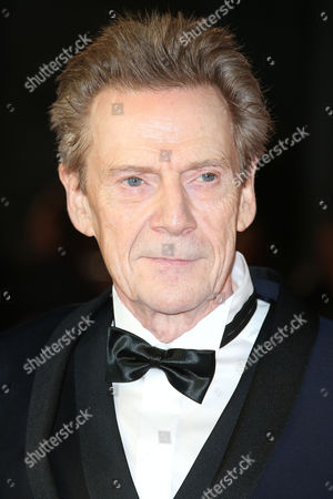 Jesper Christensen poses for photographers on arrival for the World Premiere of the latest Bond film, Spectre, at the Royal Albert Halll in central London