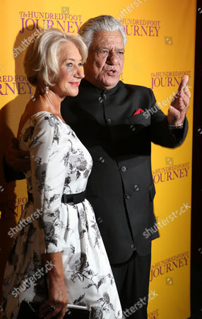 British actors Helen Mirren, left, and Om Puri pose for photographers as they arrive for the UK gala screening of the film The One Hundred Foot Journey, at the Curzon Mayfair in central London, England