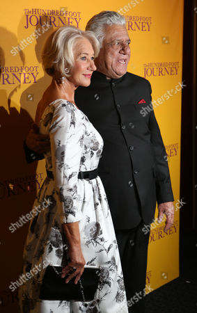 British actress Helen Mirren and Om Puri pose for photographers as they arrive for the UK gala screening of the film The One Hundred Foot Journey, at the Curzon Mayfair in central London, England
