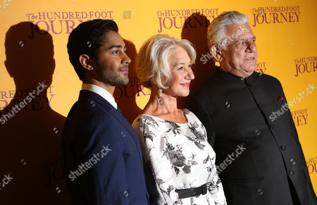 British actress Helen Mirren, Om Puri, U.S and actor Manish Dayal, left, arrive for the UK gala screening of the film The One Hundred Foot Journey, at the Curzon Mayfair in central London, England